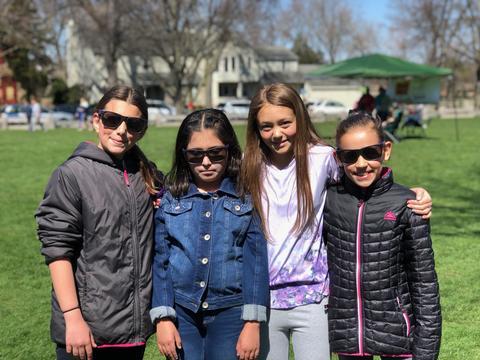 four girls posing in sunglasses