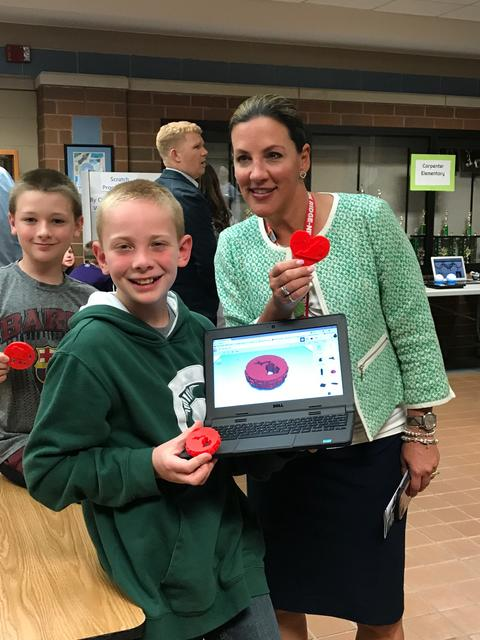 student displaying project with Dr. Heinz