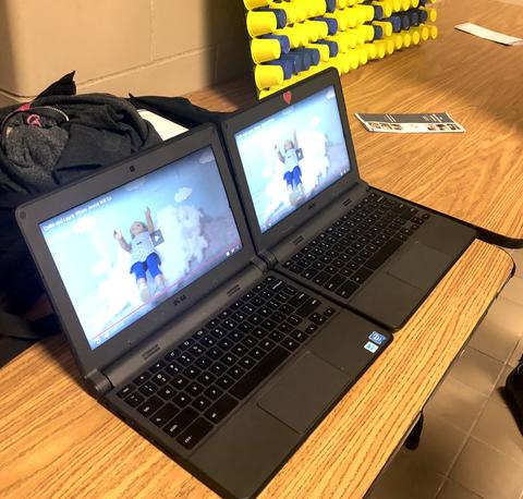 two chromebook screens displaying robots
