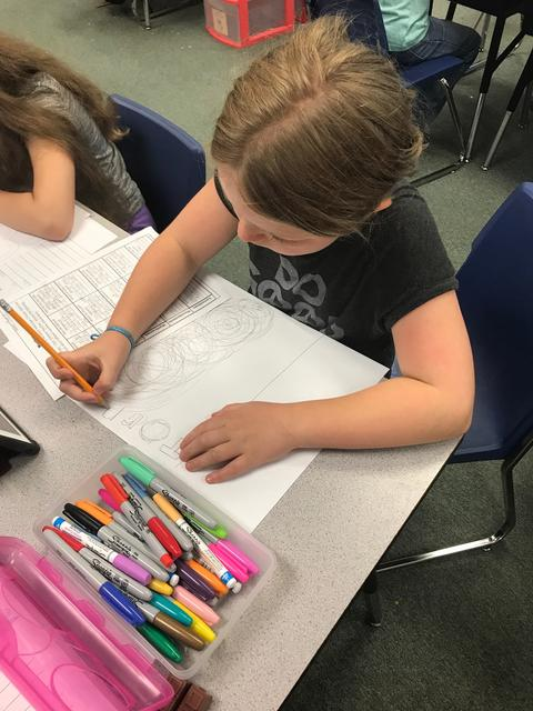 student coloring tornado poster