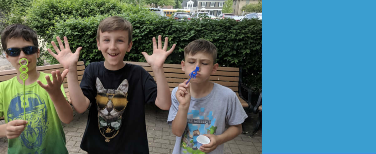 Three students blowing bubbles