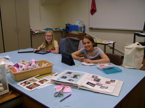 Two girls working on photo albums