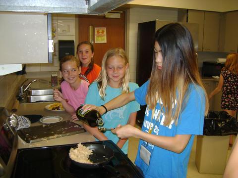 students measuring ingredients