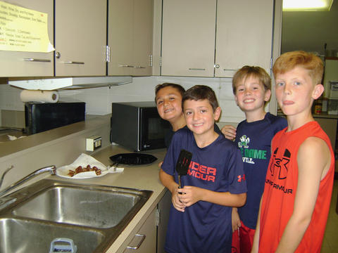 boys gathered at the sink