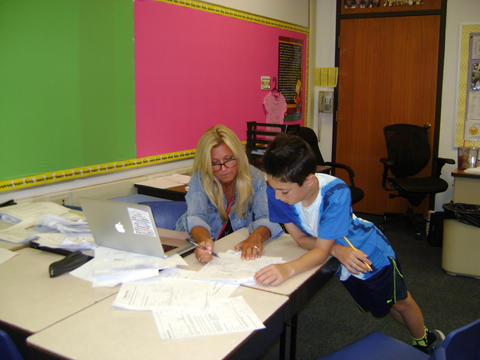 student working with a teacher