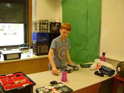 student working on robotics
