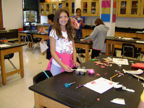 Girls creating table top wagon