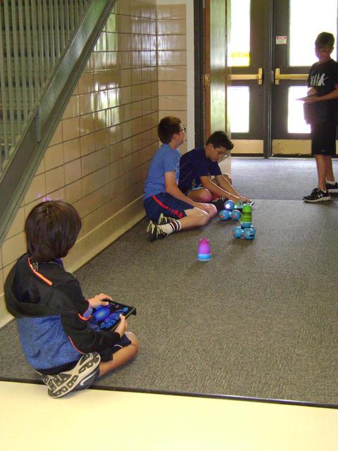 boys in hallway with osmos