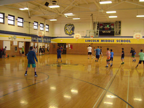 wide shot of students in the gym