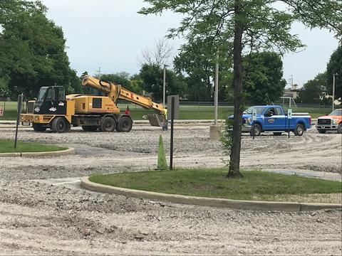 Trucks working in parking lot