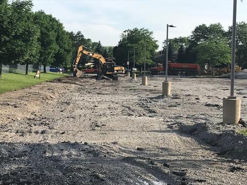 Heavy machinery working in parking lot