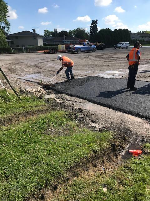 Laying asphalt in parking lot