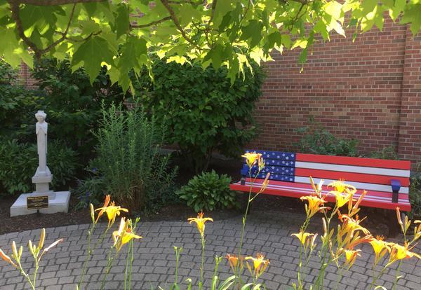 Flag bench in reading garden