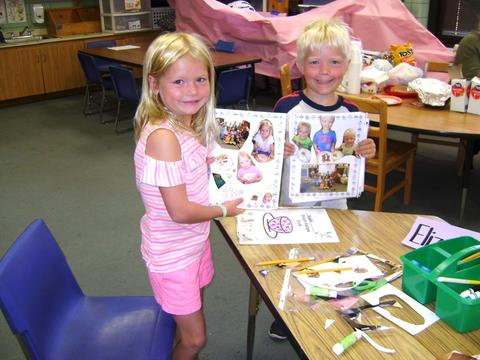 Students displaying scrap books