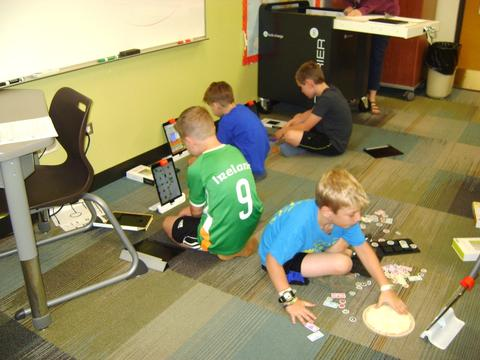 boys playing games on the floor