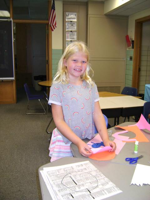Girl creating project with construction paper