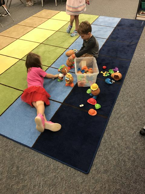 students playing with Mr. Potato Head
