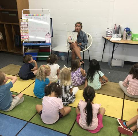teacher reading to students in EDK
