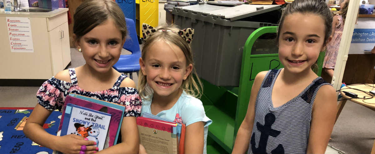 Girls holding their library books