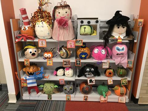 Shelves of decorated pumpkins