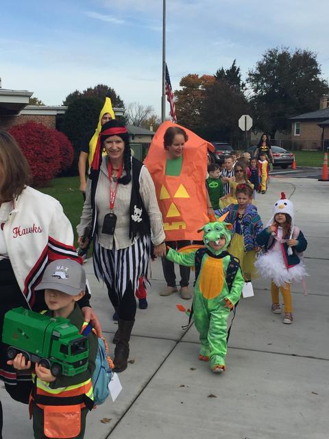 Pirate, pumpkin, dinosaur, and cheerleader for Halloween