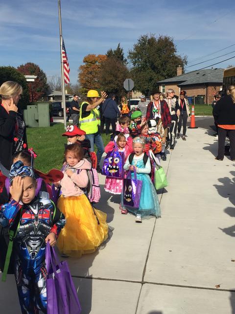 Preschoolers battle the sunshine in Halloween parade