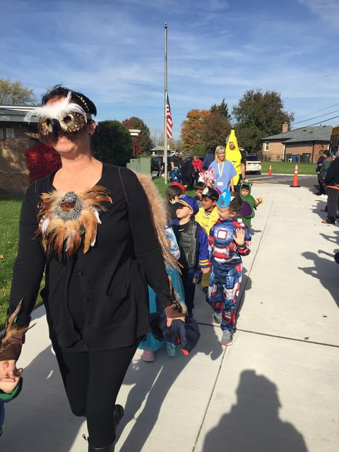 Preschoolers parade outside for Halloweeen