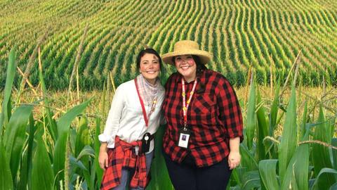 farmers in a corn field
