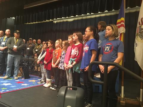 veterans and students on stage