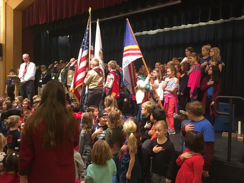 color guard on stage with principal