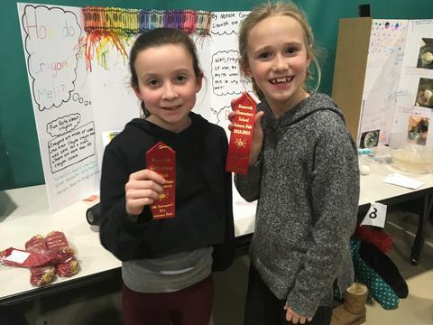 girls holding ribbons