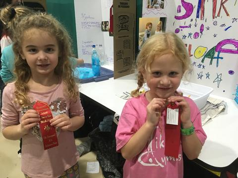 girls with science fair ribbons