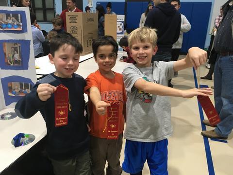 boys holding up ribbons