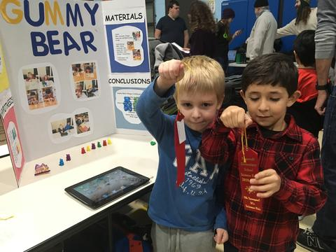 boys with science fair ribbons