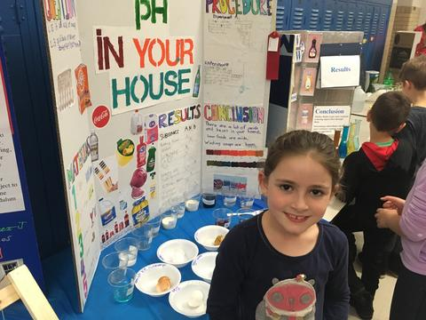 girl with science project