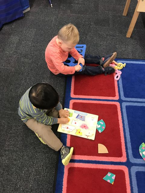 two boys doing puzzles