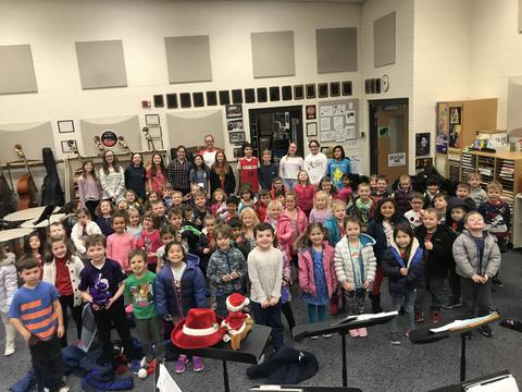 Kindergarten students with 7th grade band