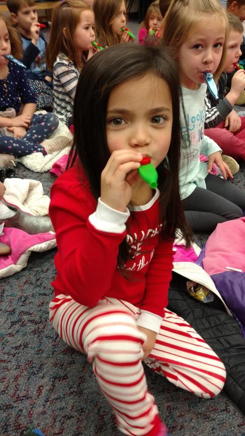 Girl practicing the kazoo