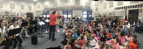 Kindergarteners playing along with Emerson band