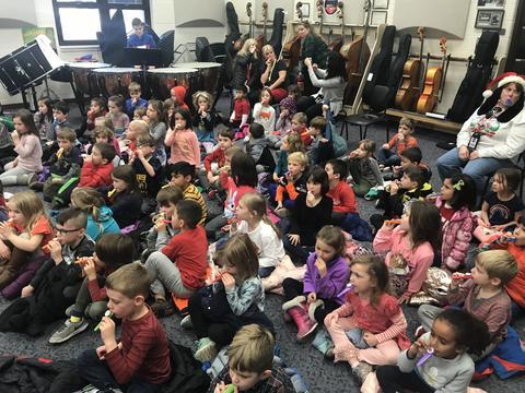 Kindergarten class practices the kazoo