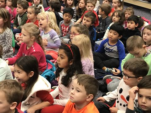 Students listen attentively to holiday concert