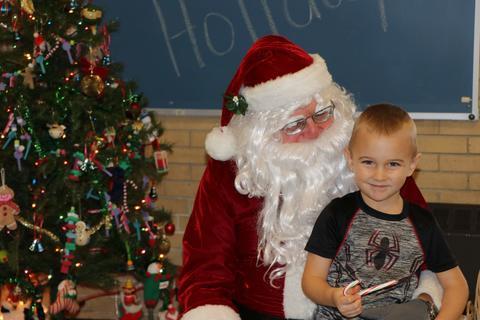 Boy sitting on Santa's lap