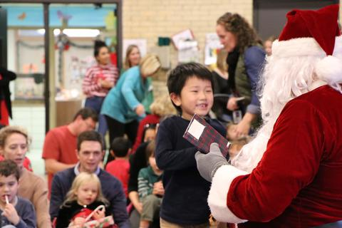 Preschool boy is excited about Santa's gift
