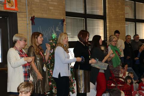 Teachers lead the singing