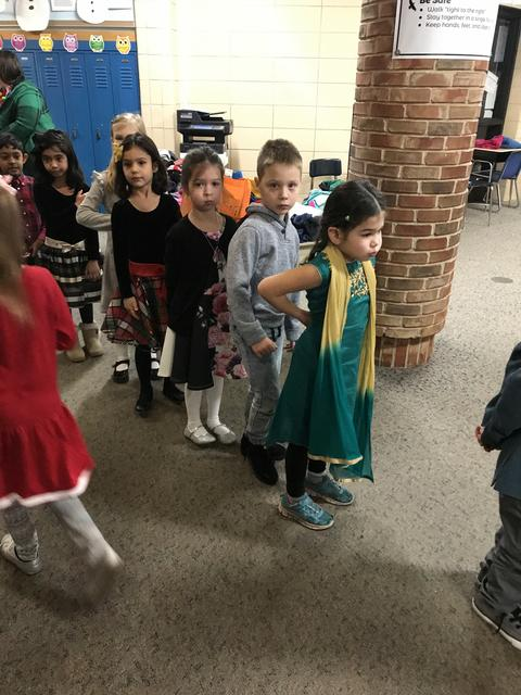 students entering gym for holiday sing