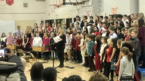 full groups of performer and teacher at holiday sing