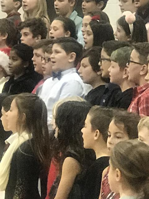 close up of several students singing