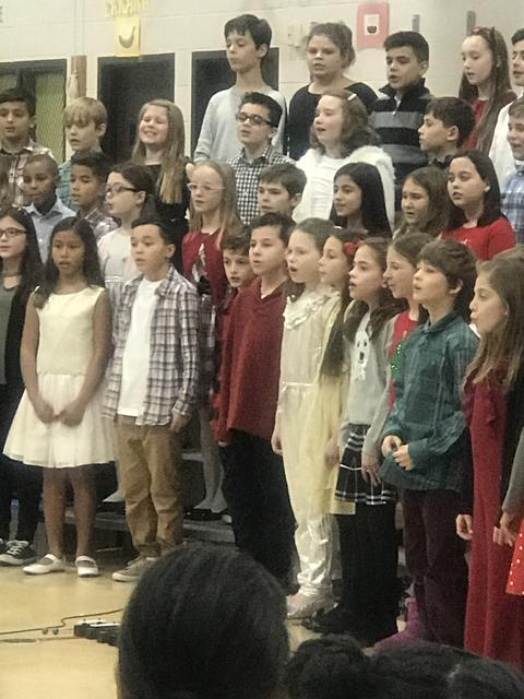 students performing at holiday assembly