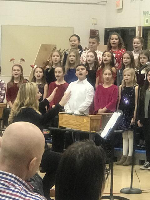 students singing at Holiday sing
