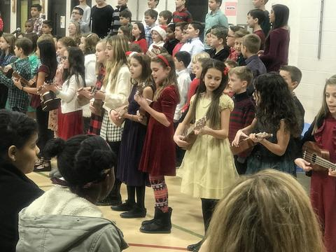holiday sing with students and ukeleles